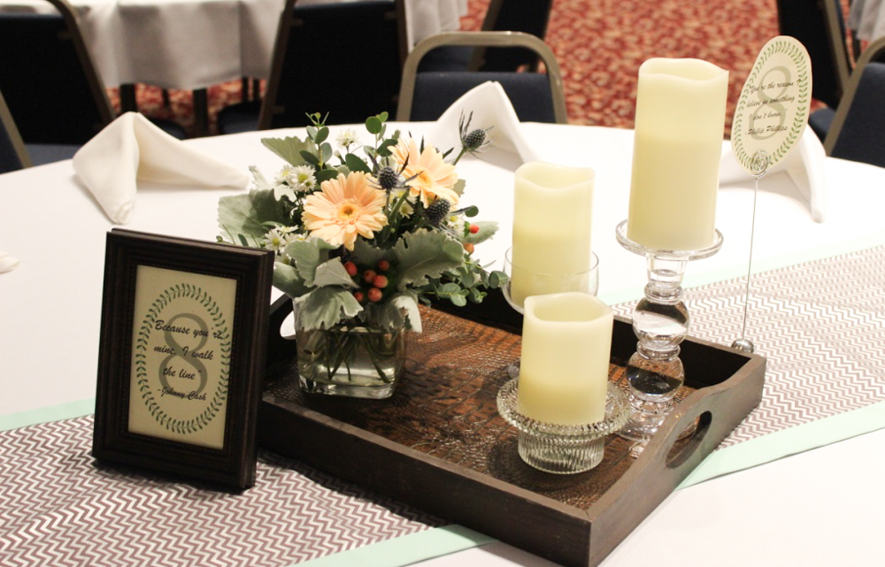 centerpiece with tray, candles, small flower arrangement