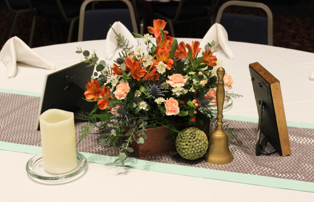 evansville wedding table centerpiece with orange and peach, candles, decorative items