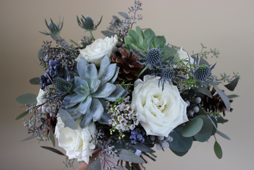 blue and white bouquet, succulents, thistle, roses, pine cones