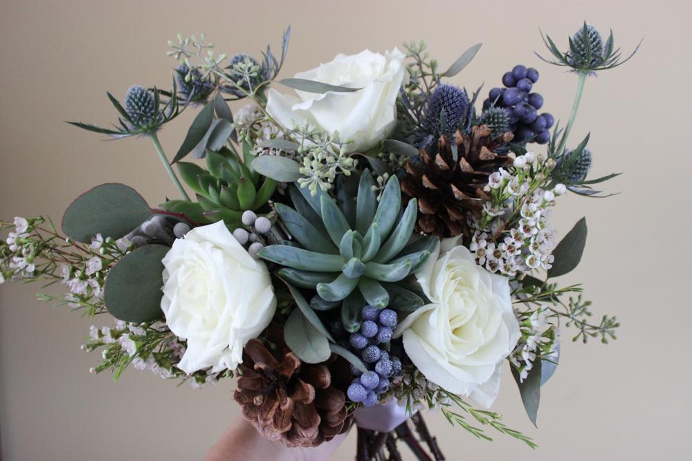 rose, thistle, succulent, pine cones, wax flower, eucalyptus