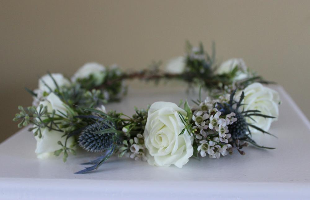 blue and white flowers, roses, thistle, wax flower, eucalyptus, flower girl