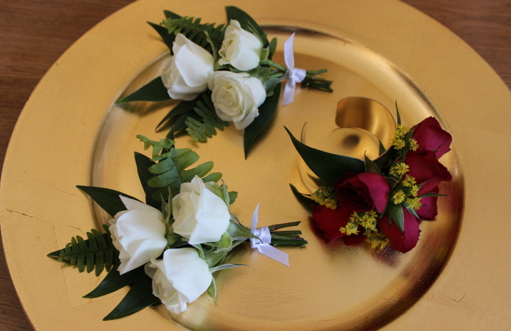 pinned corsage, wrist corsage, white flowers, red flowers