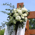 white wedding, white wedding flowers, ceremony flowers, wedding arch