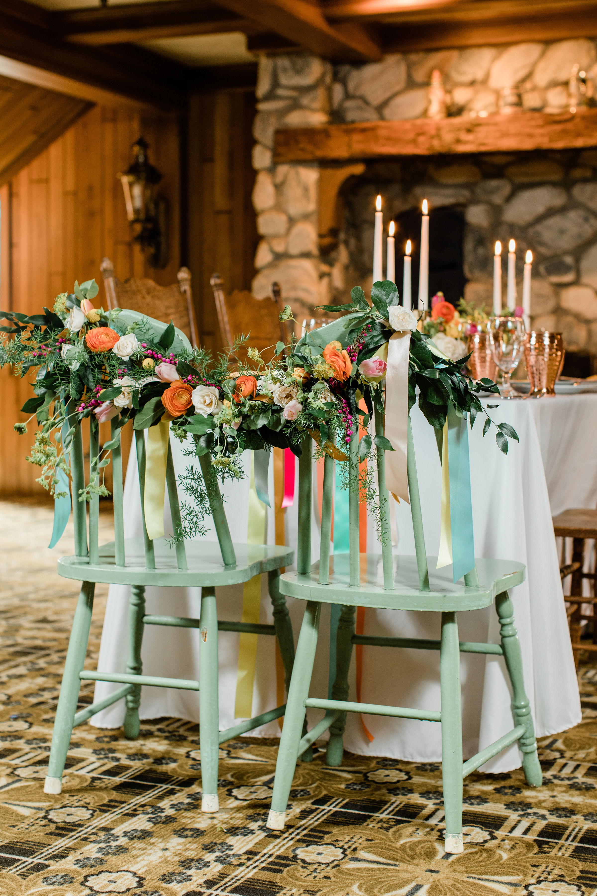 bride and groom chairs with floral garland