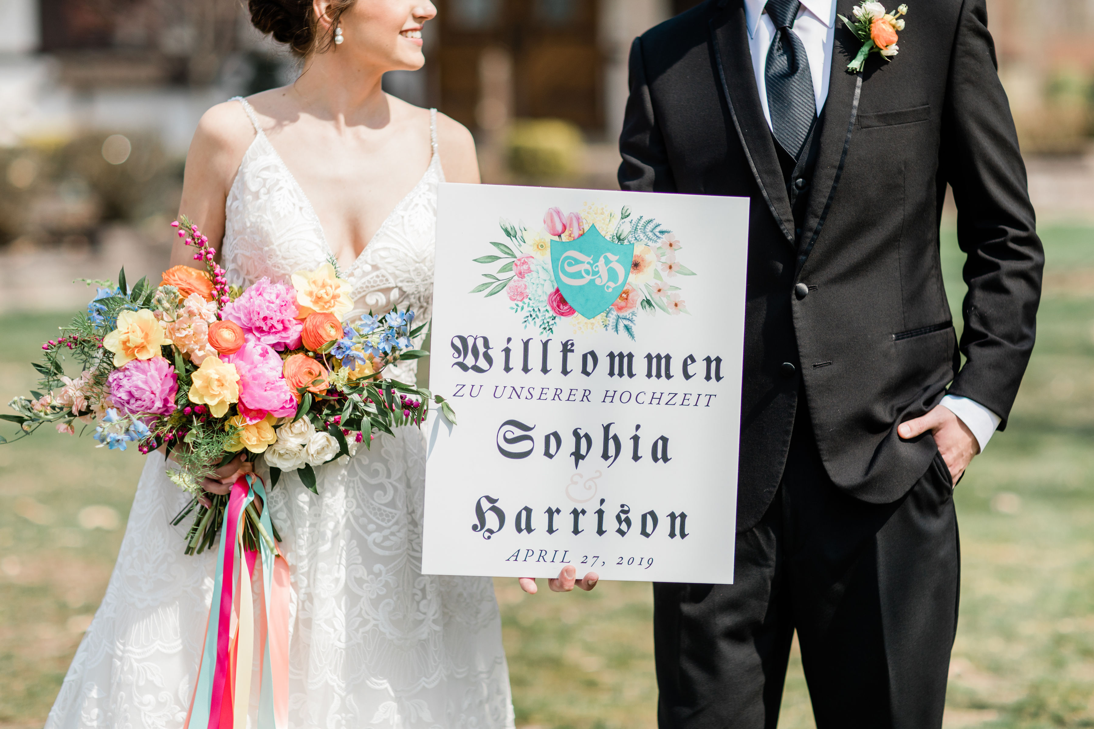 wedding at the bauerhaus in evansville indiana, brightly colored spring bouquet by emerald design, sign by 5 pink peonies