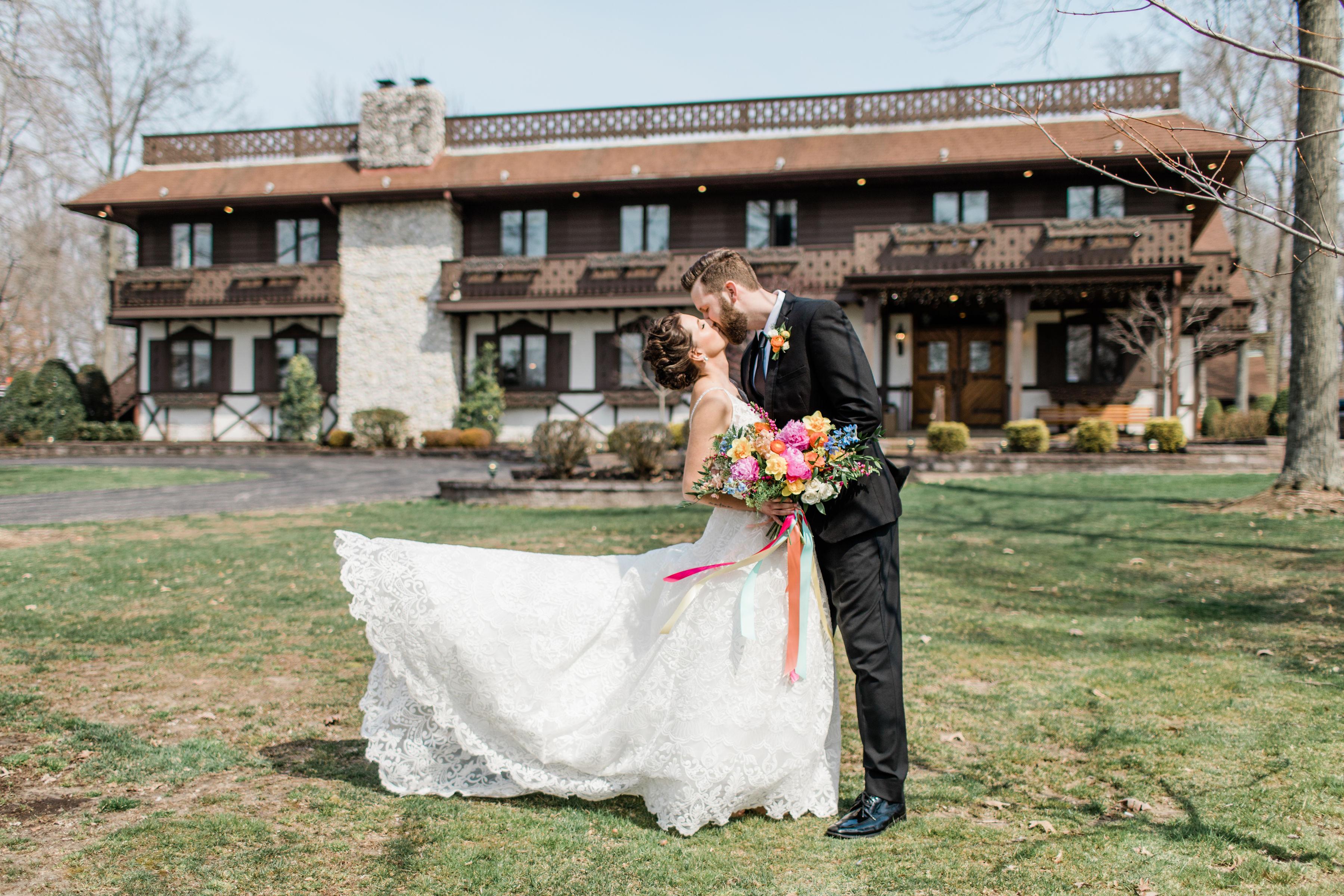 bride and groom standing in front of the Bauerhaus in Darmstadt, Indiana