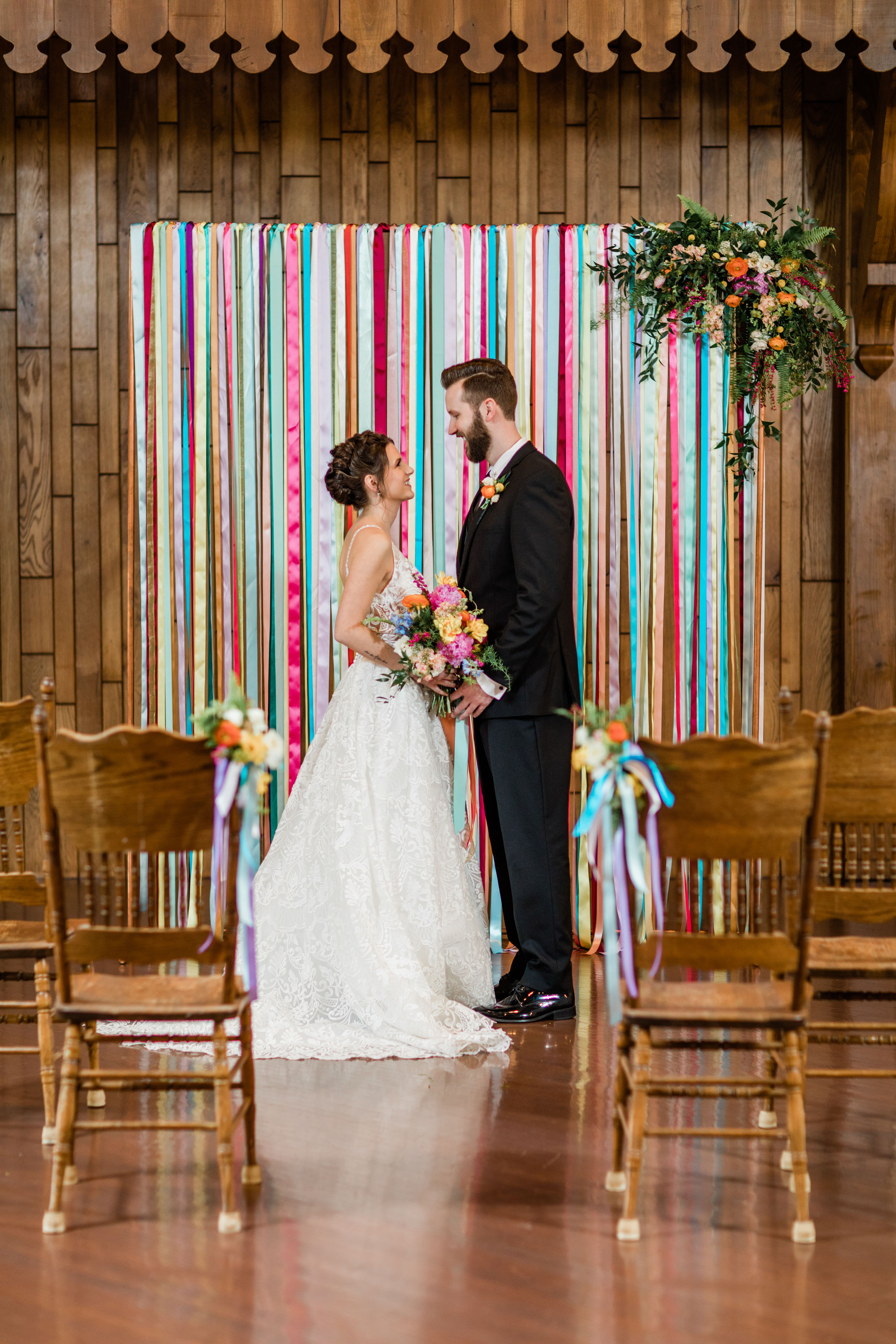 bauerhaus wedding ceremony in front of ribbon backdrop