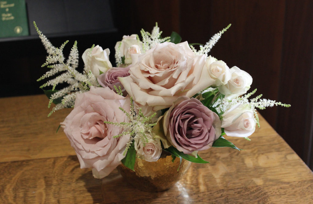 mauve, blush roses in an entry arrangement with white astilbe
