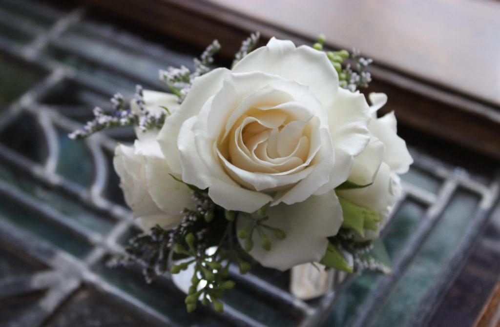 white floral wrist corsage