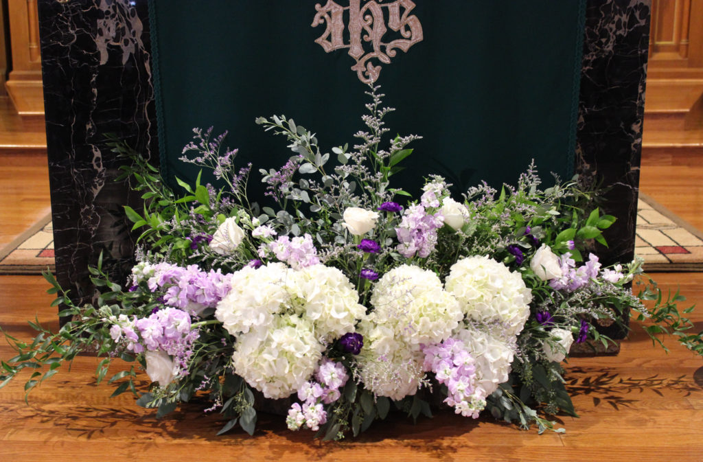 purple and white floral altar arrangement