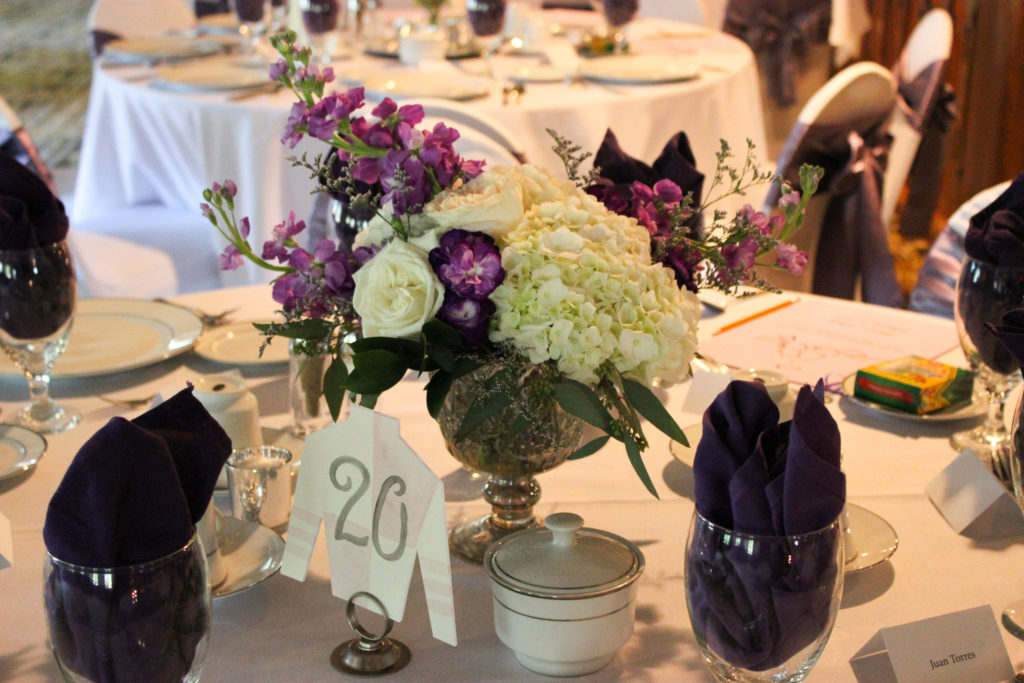 purple and white floral arrangement in silver compote