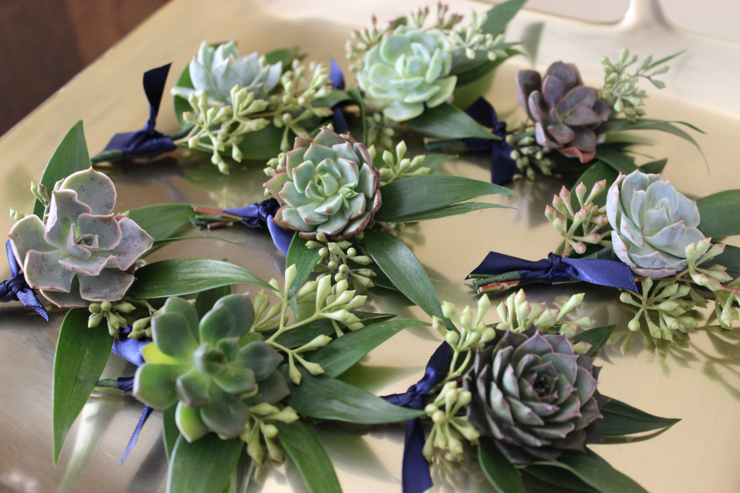 succulent boutonnieres by emerald design