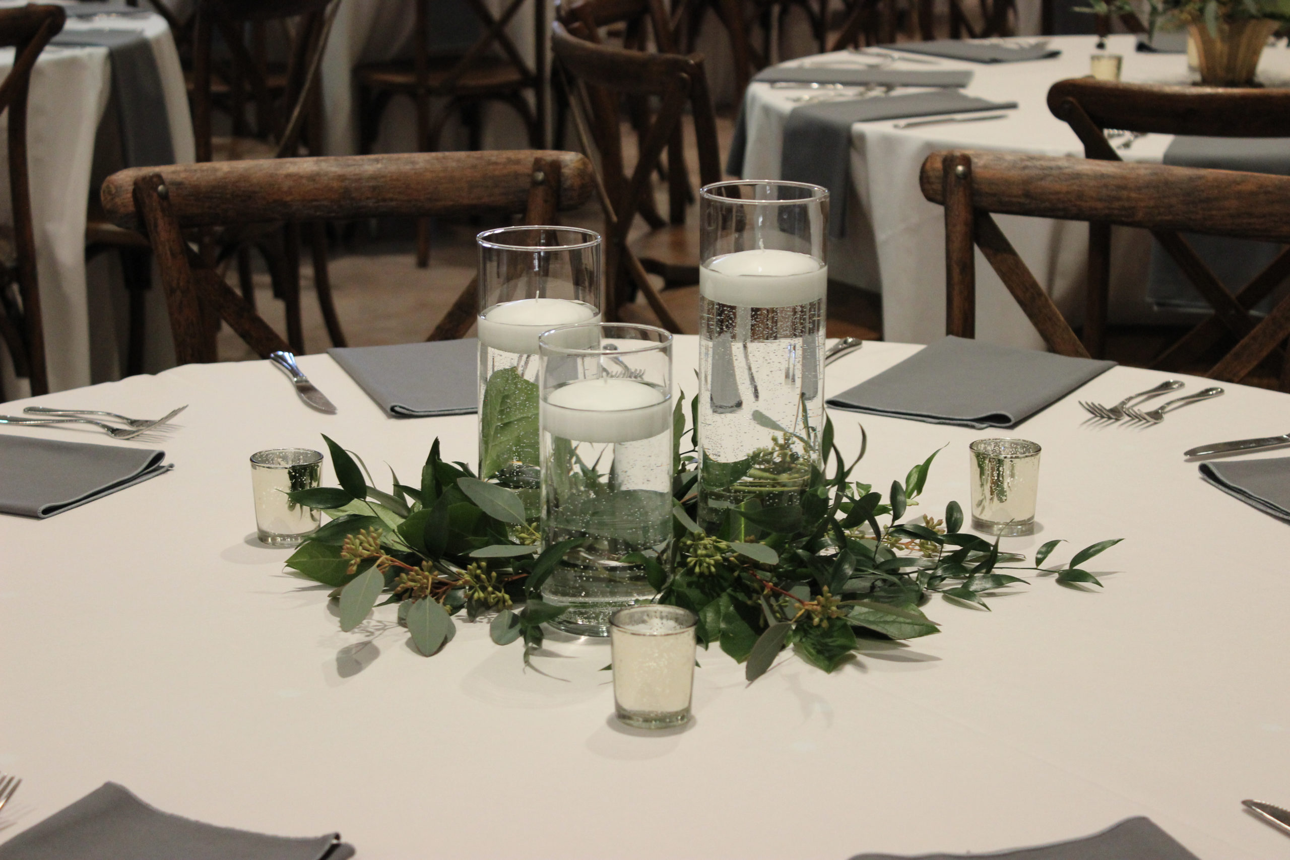 candlescape with greenery for a wedding at city view