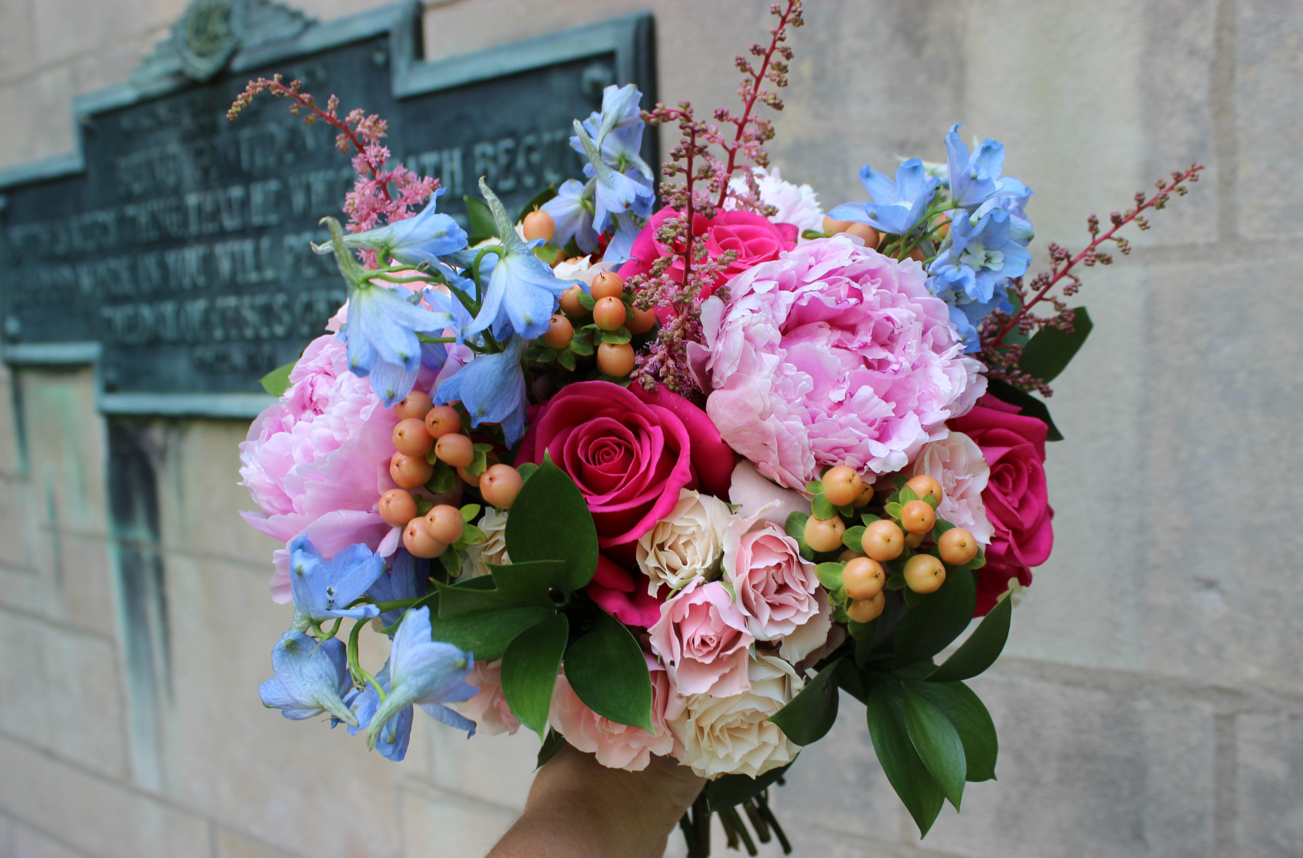 spring bridal bouquet with bright pastel colors