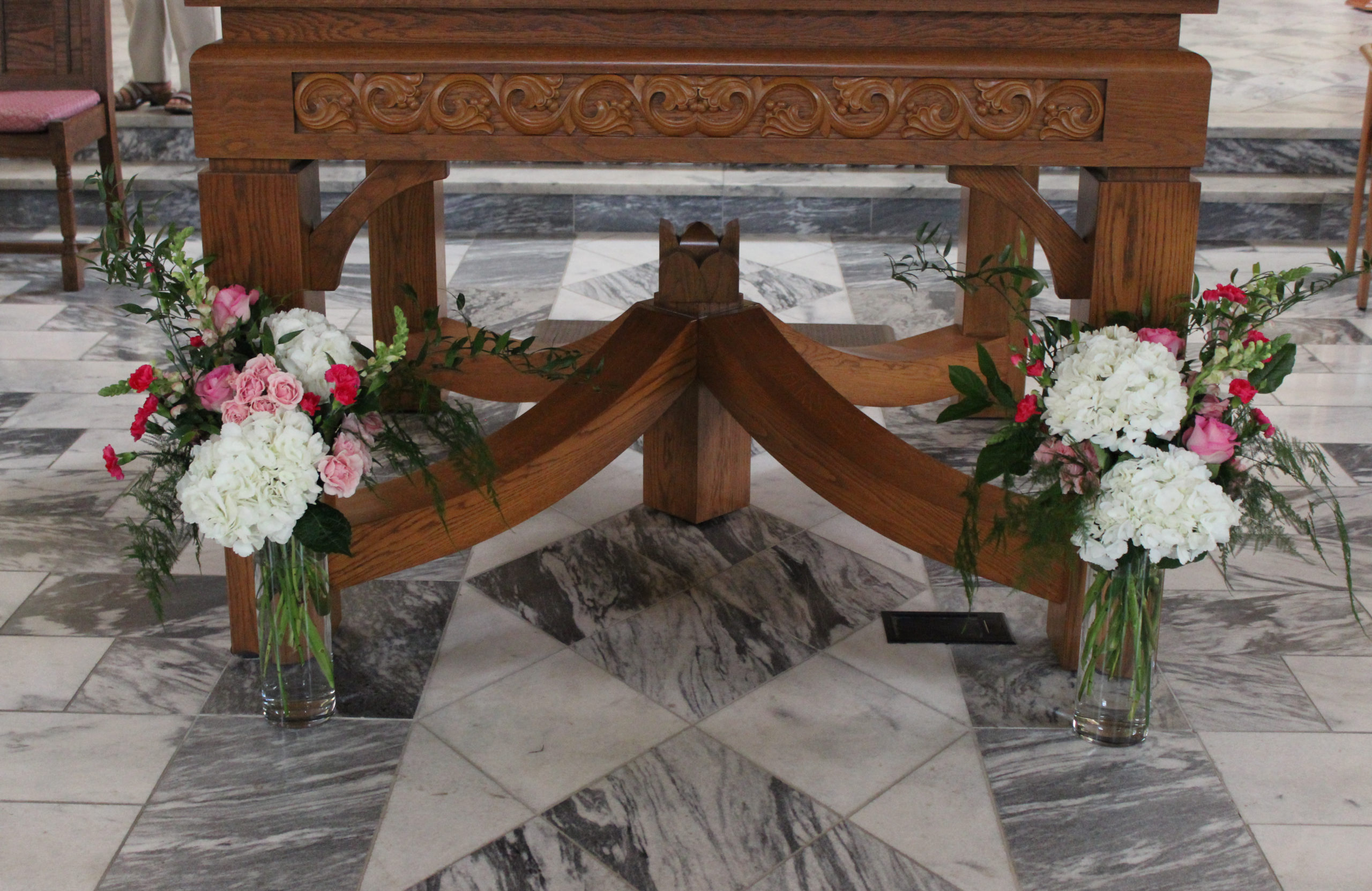 altar arrangements for a wedding at st anthony catholic church in evansville by florist emerald design