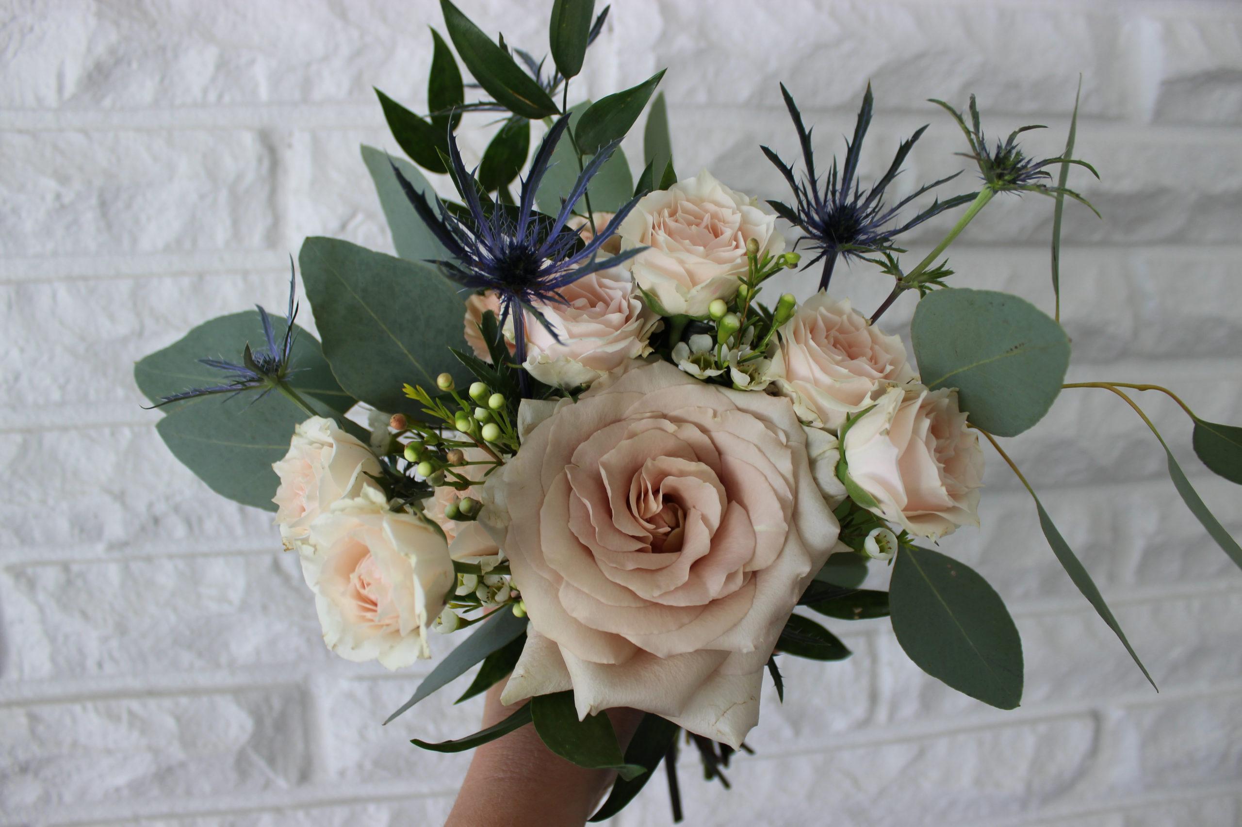 blush and blue bridesmaid bouquet by evansville florist emerald design