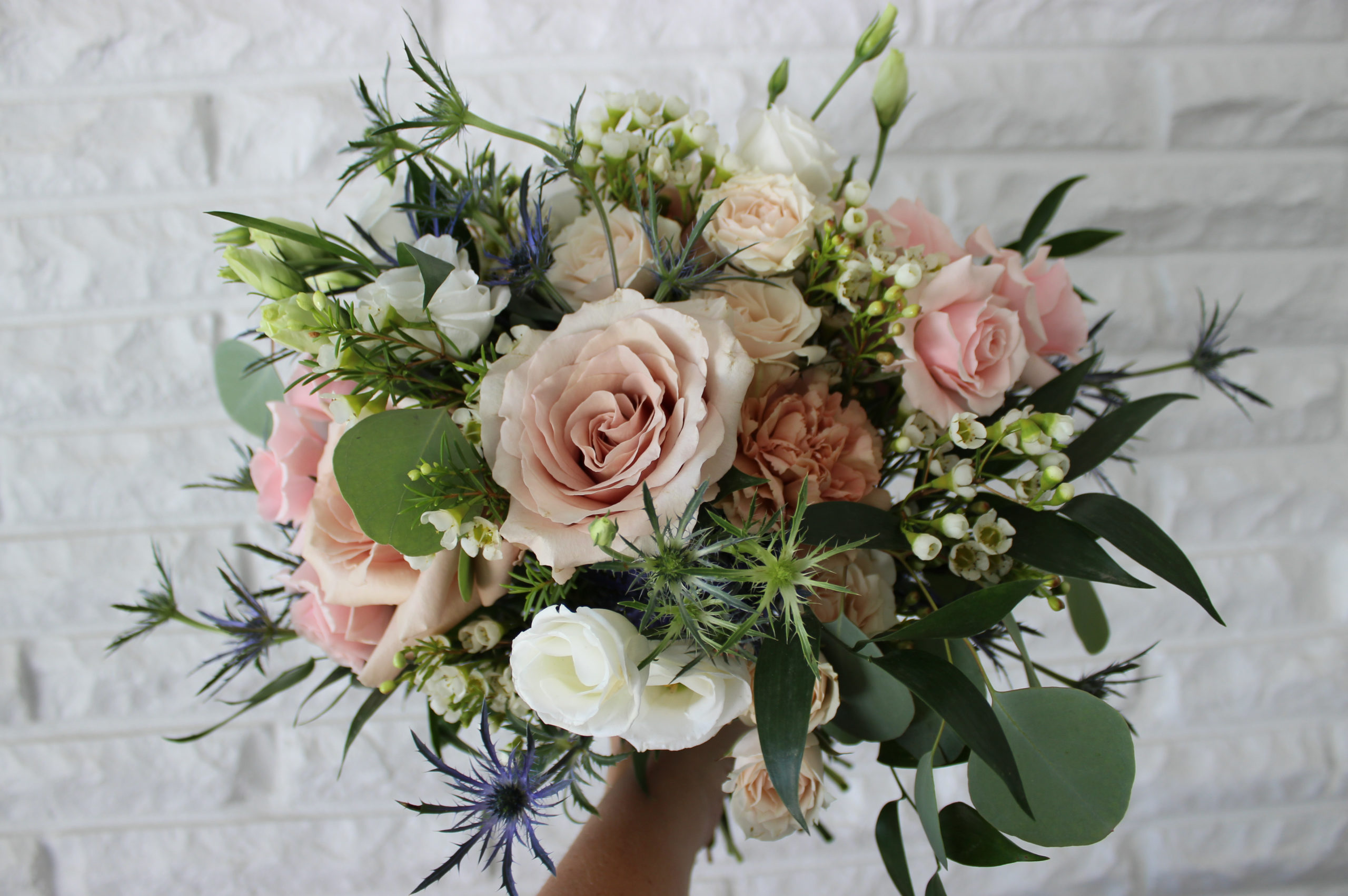 bridal bouquet created by evansville florist emerald design