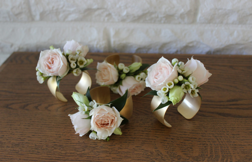 blush and gold wrist corsages for an evansville wedding created by emerald design
