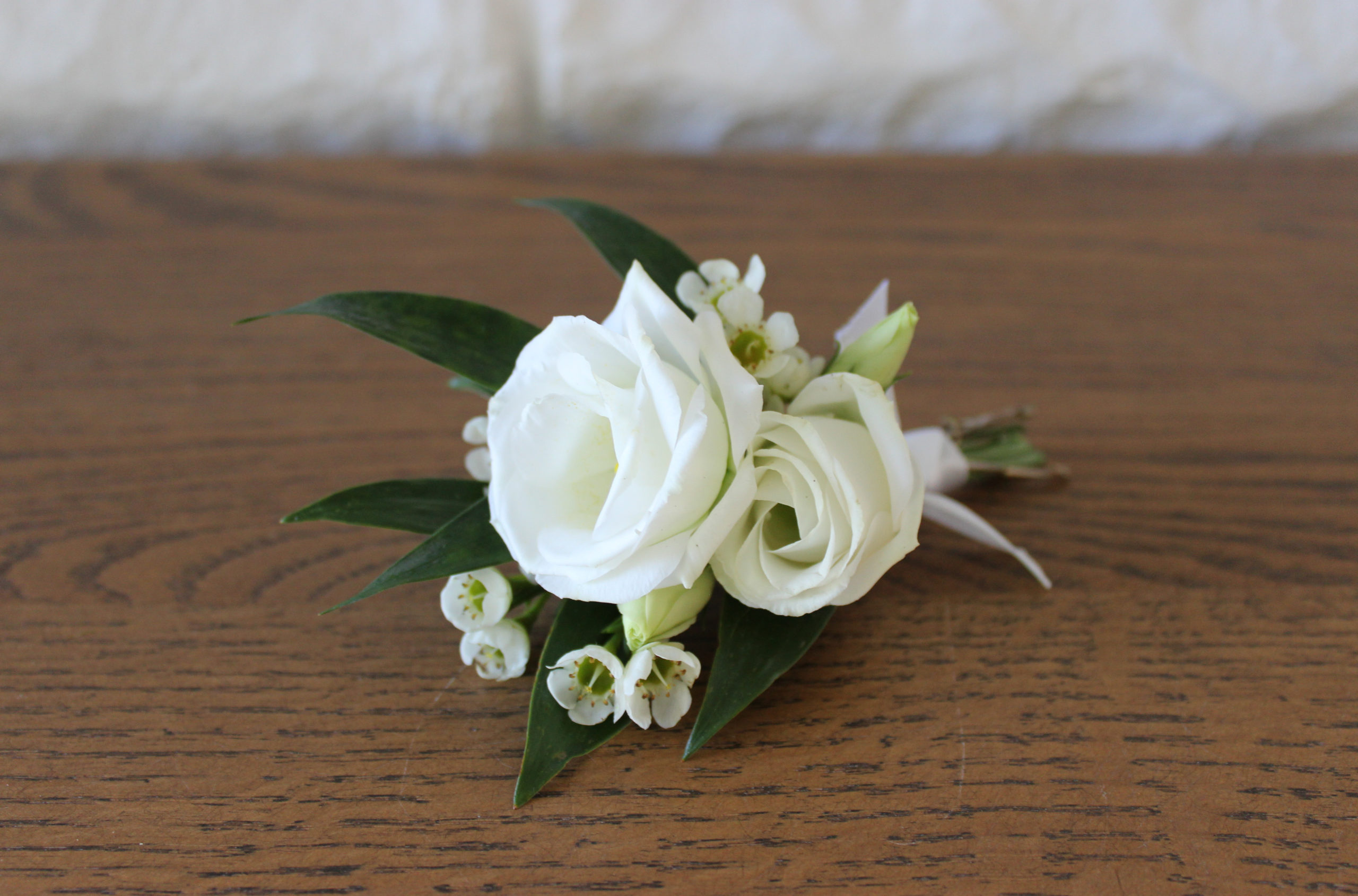 white boutonniere for an evansville wedding created by florist emerald design
