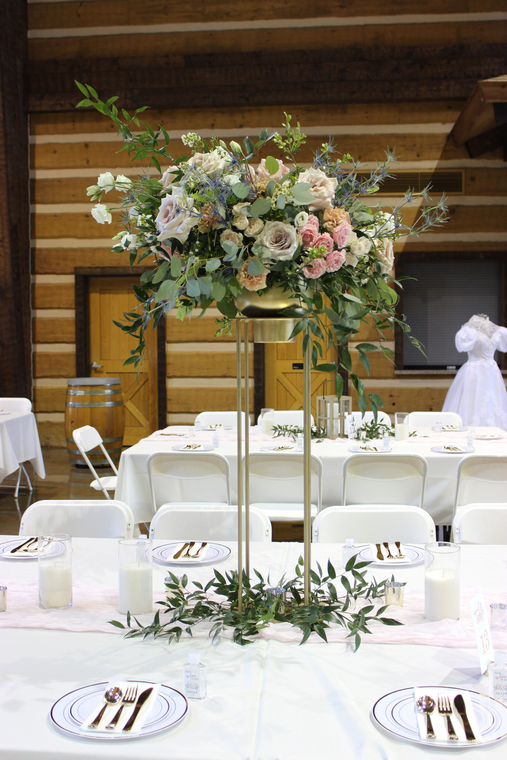 elevated floral centerpiece created by florist emerald design for an evansville wedding