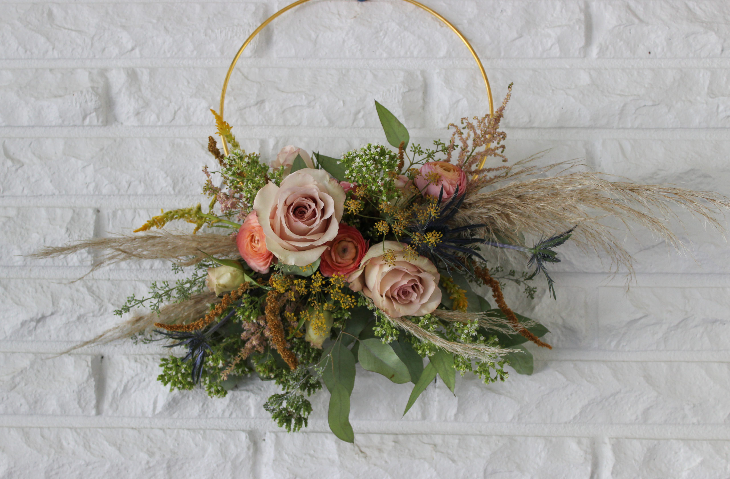 hoop bouquet for a boho wedding by evansville florist emerald design