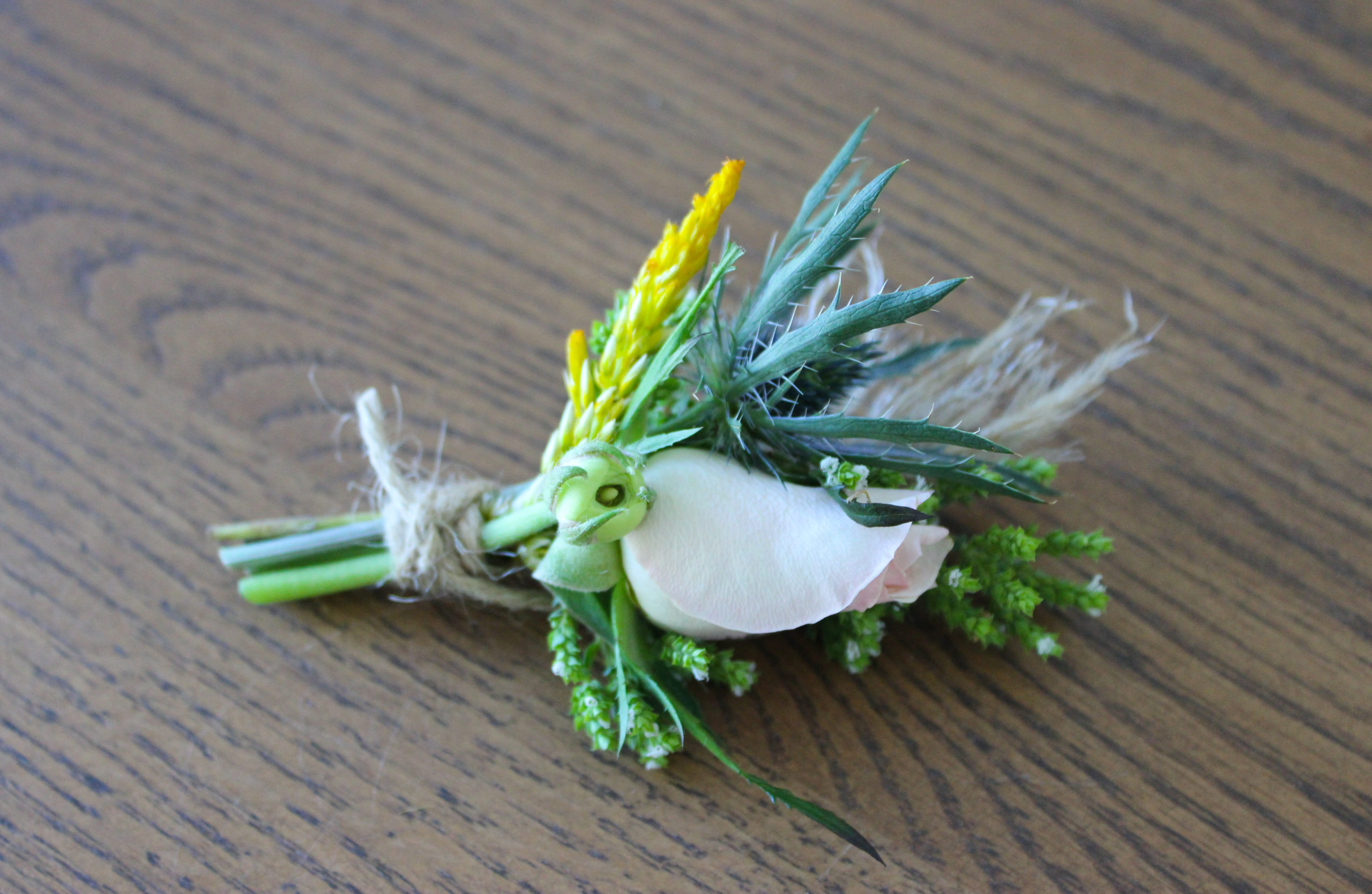 boutonniere created by an evansville wedding by florist emerald design