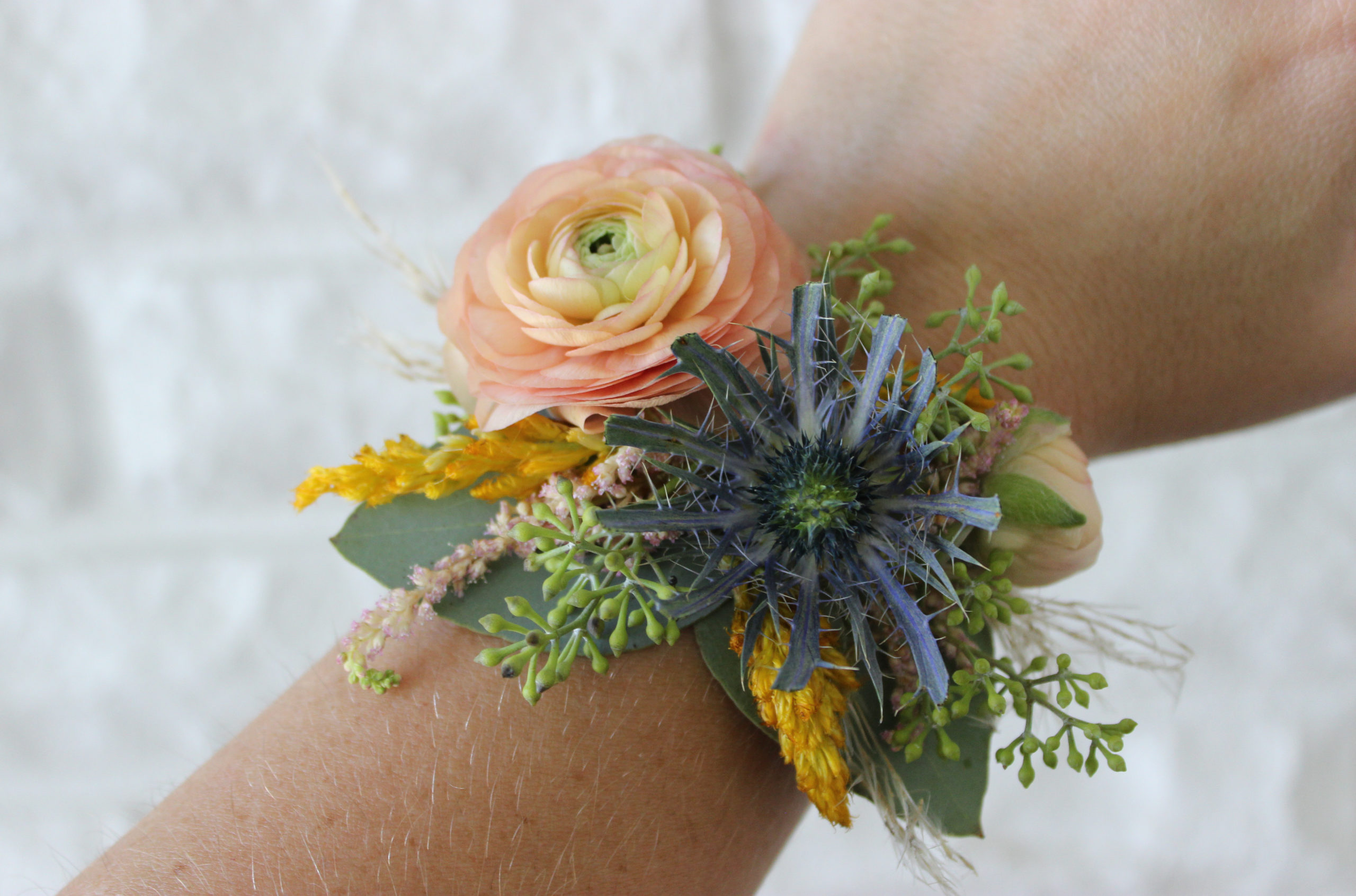 wrist corsage created by an evansville wedding by florist emerald design