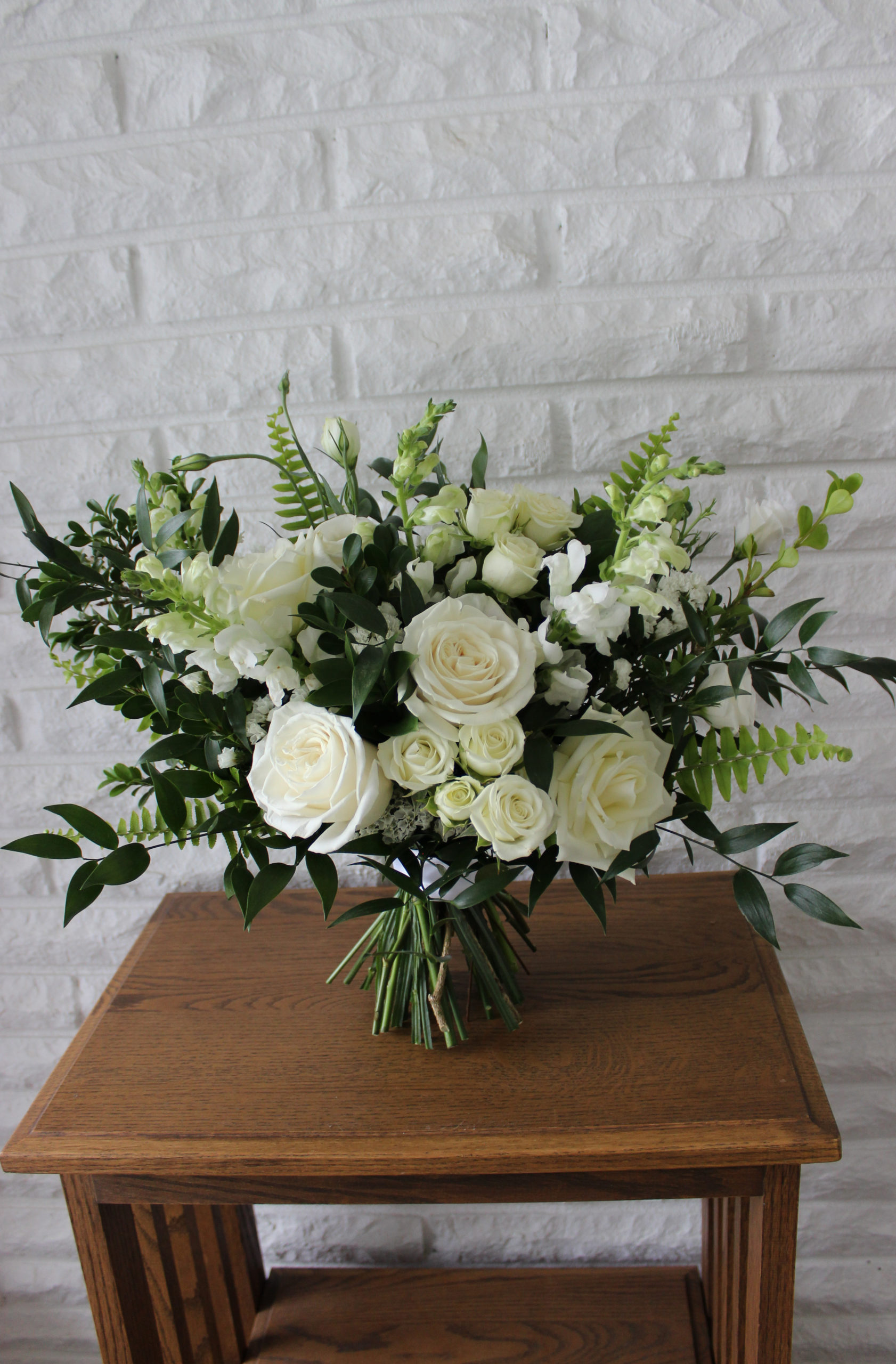 classic white bridal bouquet created by emerald design of evansville for a wedding in henderson kentucky