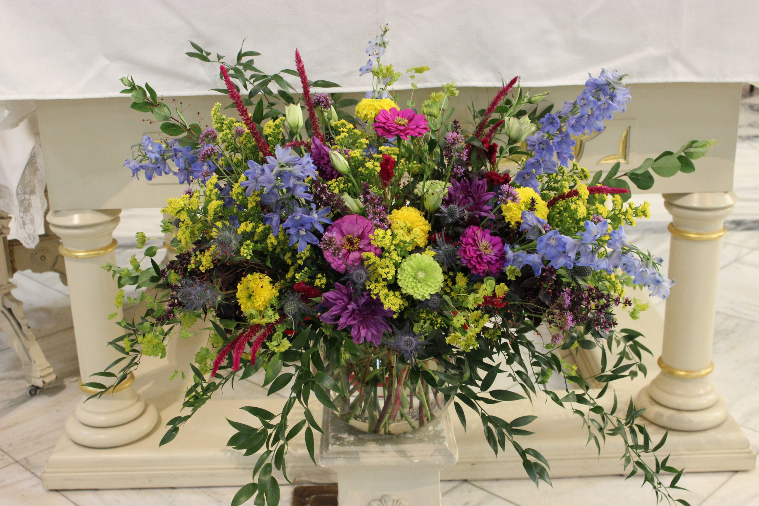 Colorful, summer flower arrangement for a wedding at St, Mary's in downtown Evansville by florist Emerald Design