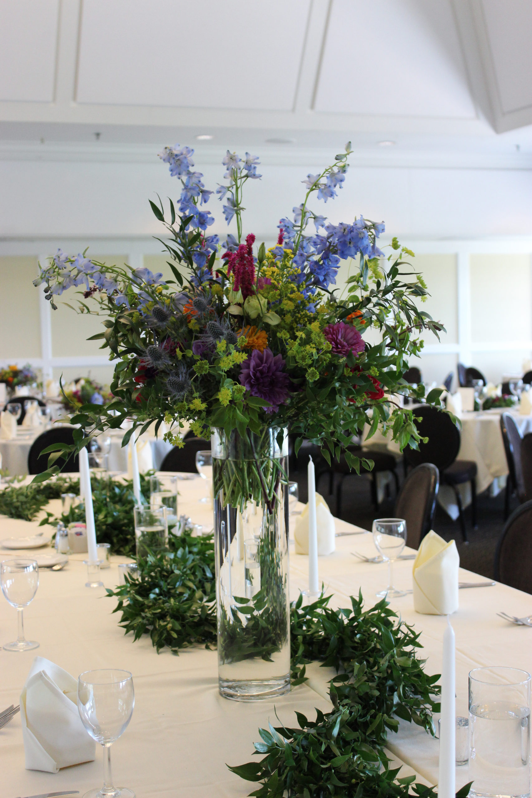 Head table decor for a wedding reception at Evansville Country Club, designed by Evansville florist, Emerald Design