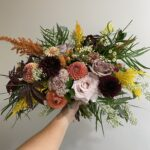 bridal bouquet for a fall wedding by evansville florist emerald design