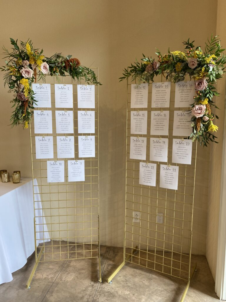 escort card display for a wedding at city view, flowers by evansville florist emerald design