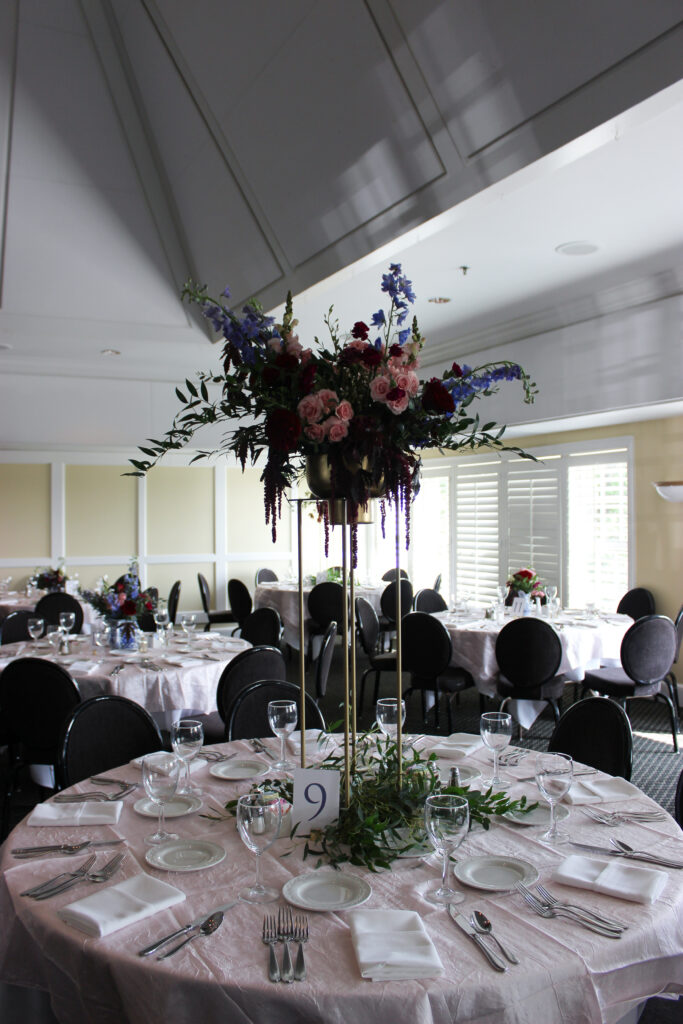 tall centerpiece by evansville florist emerald design for a wedding at evansville country club