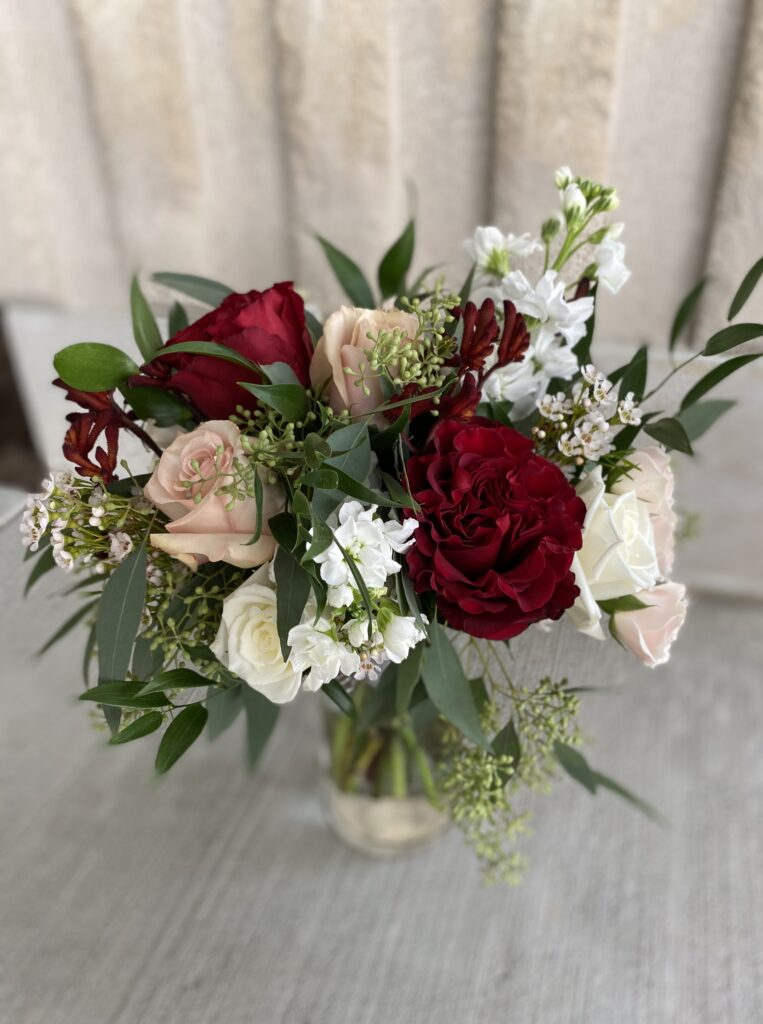 blush and burgundy bridal bouquet created by evansville florist emerald design