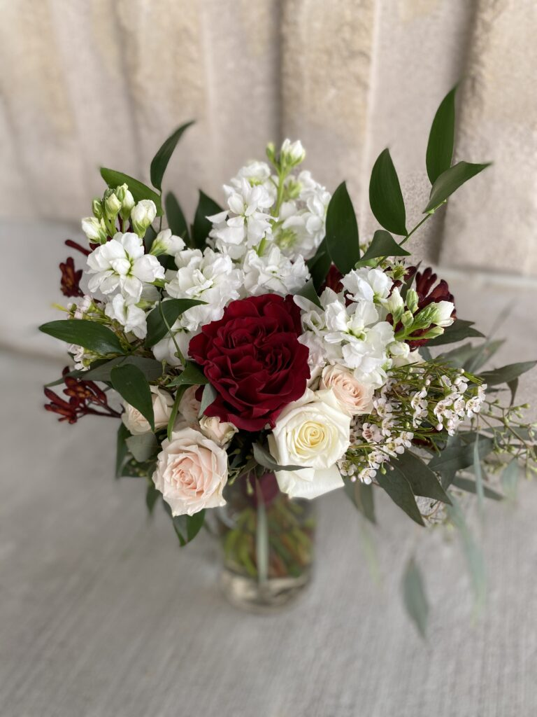 blush and burgundy bridesmaid bouquet created by evansville florist emerald design
