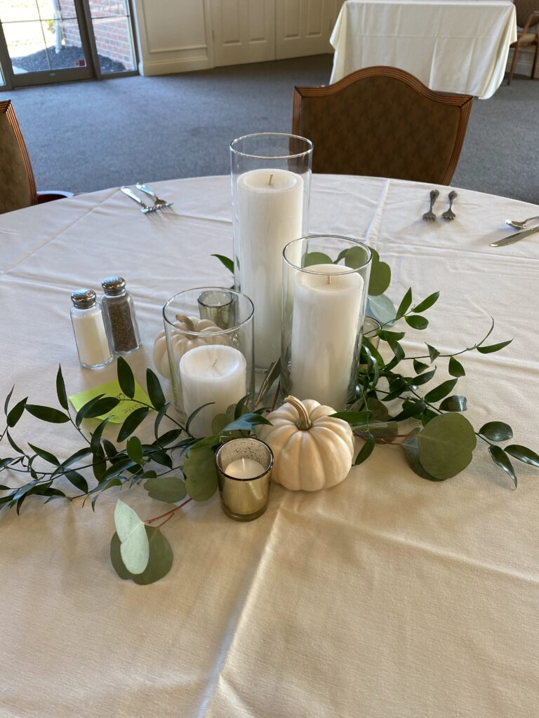 Floral centerpiece created by evansville florist emerald design for a wedding at cambridge golf club