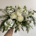 white bridal bouquet created by evansville florist emerald design for a december wedding