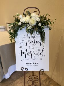 entry sign for wedding at city view, flowers by emerald design