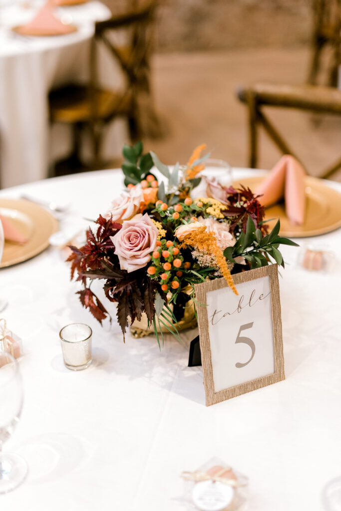 Floral centerpiece by evansville florist emerald design for a september wedding at City View. Photo by Morgan Marie Photography.