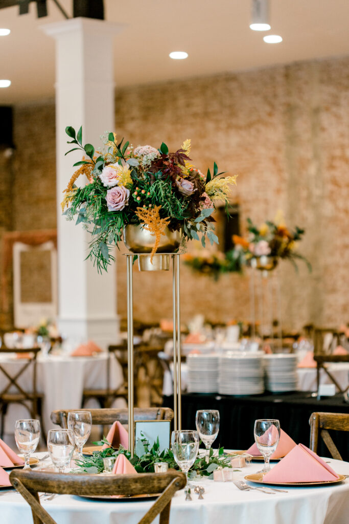 tall floral centerpiece by evansville florist emerald design for a september wedding at City View. Photo by Morgan Marie Photography.