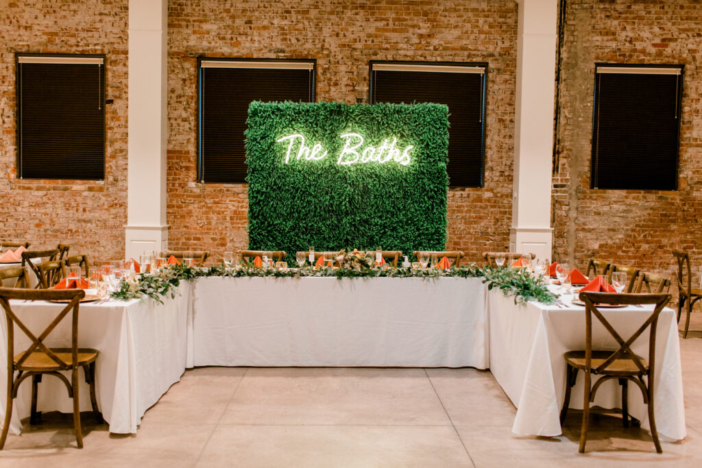 Flower installation by Evansville florist Emerald Design for a wedding at City View. Photo by Morgan Marie Photography.