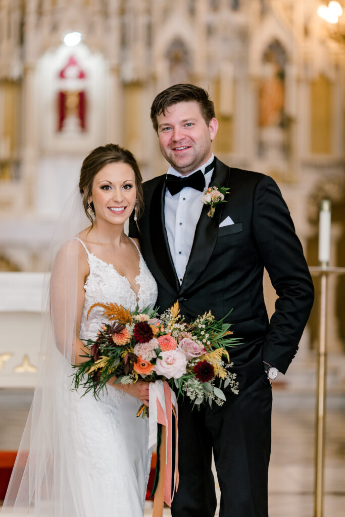 fall wedding ceremony at saints mary and john catholic parish in evansville indiana, flowers by emerald design, photo by morgan marie photography