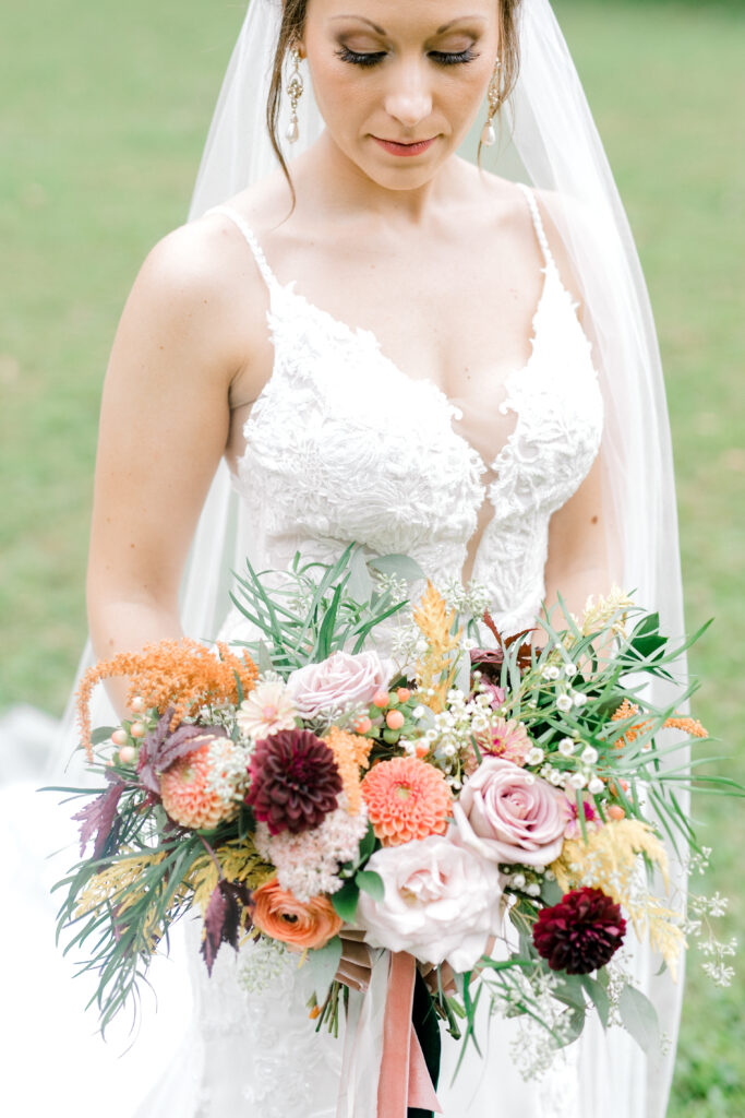 bride and bridal bouquet, flowers by evansville florist emerald design, photo by morgan marie photography