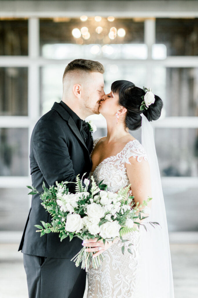 bride and groom at an august wedding at farmer and frenchman in robards, kentucky. flowers by evansville florist emerald design, photos by terre haute photographer shillawna ruffner