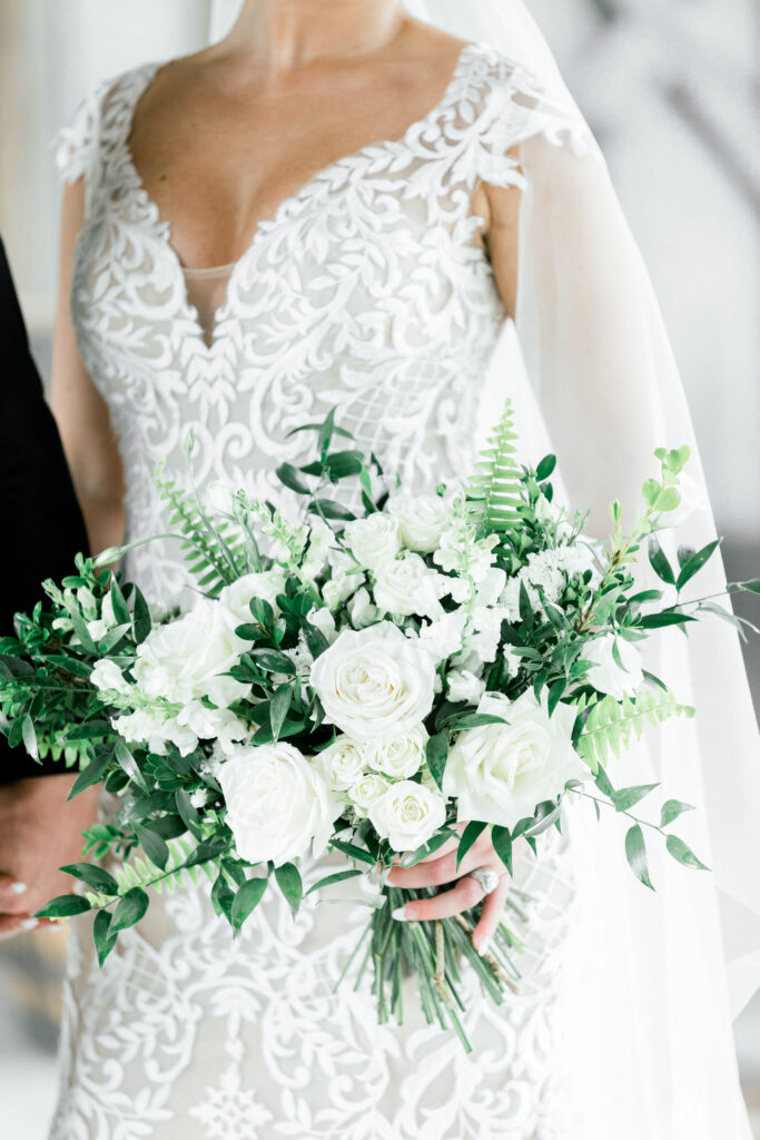 white bridal bouquet for a kentucky wedding at farmer and frenchman by evansville florist emerald design photo by shillawna ruffner