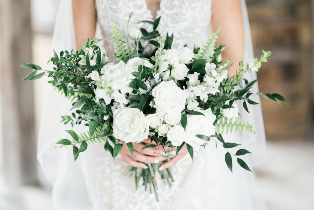 white bridal bouquet created for a kentucky wedding by evansville florist emerald design, photo by shillawna ruffner
