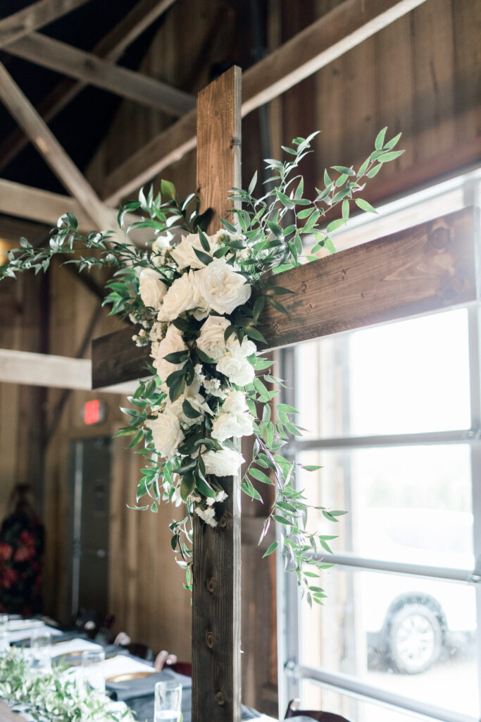 ceremony cross at an august wedding at farmer and frenchman, flowers by emerald design