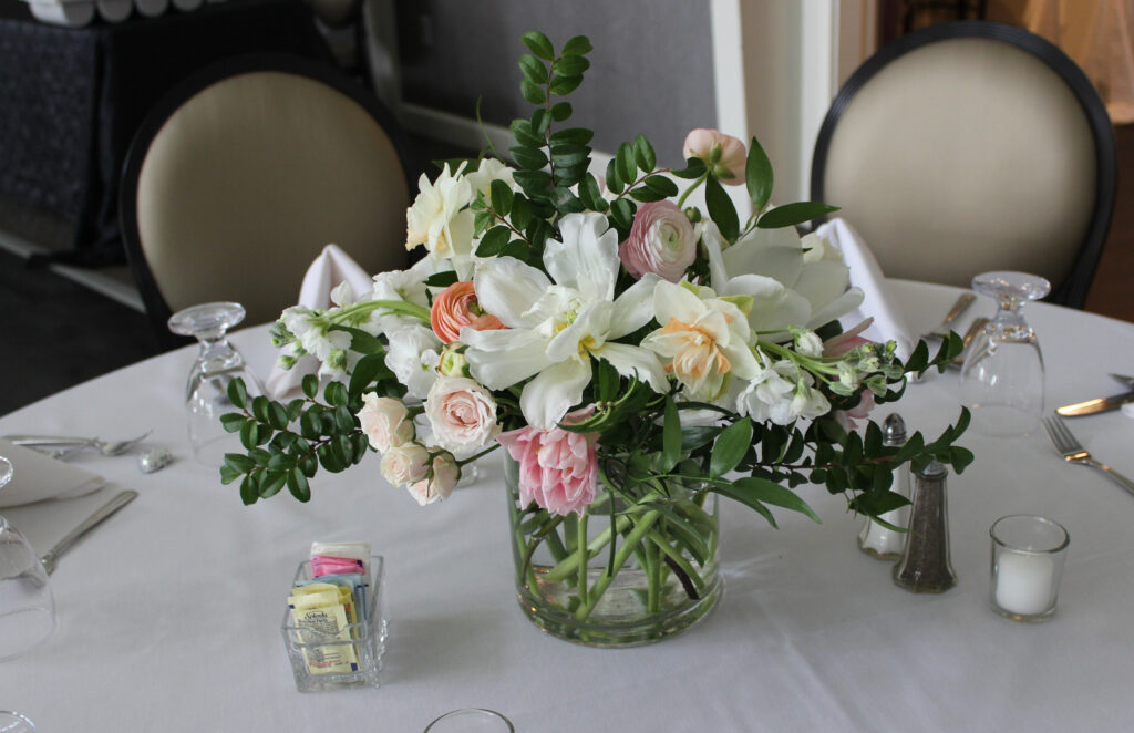 floral centerpiece created by evansville florist emerald design for a wedding reception at rolling hills country club in newburgh, indiana